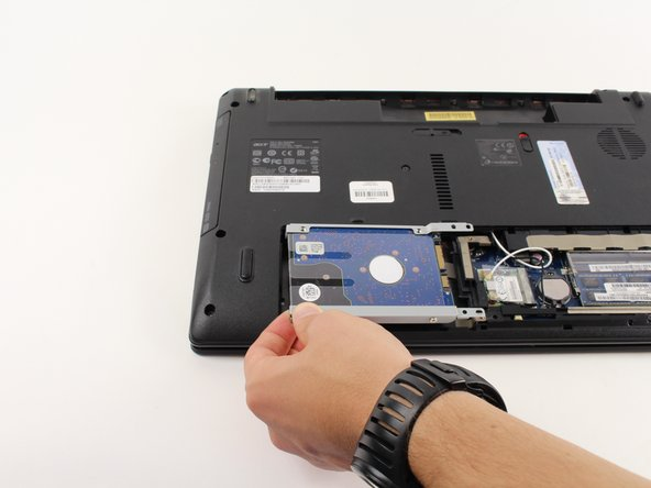 Pull the hard drive out of its compartment.