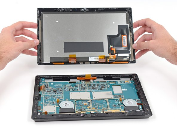 We flick aside four ribbon cables, and with that, this tablet's internals are revealed to the world.