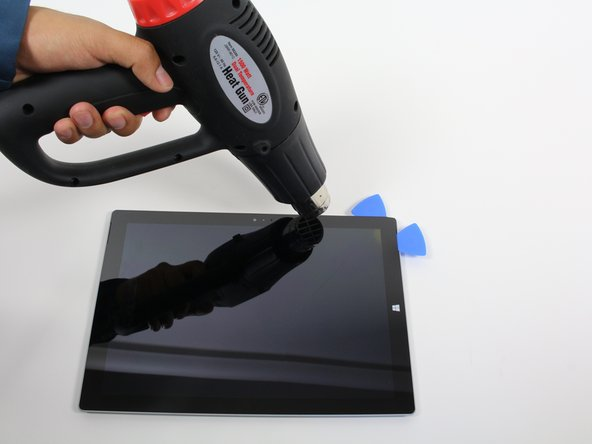 Continue to heat sections of the screen with the heat gun.