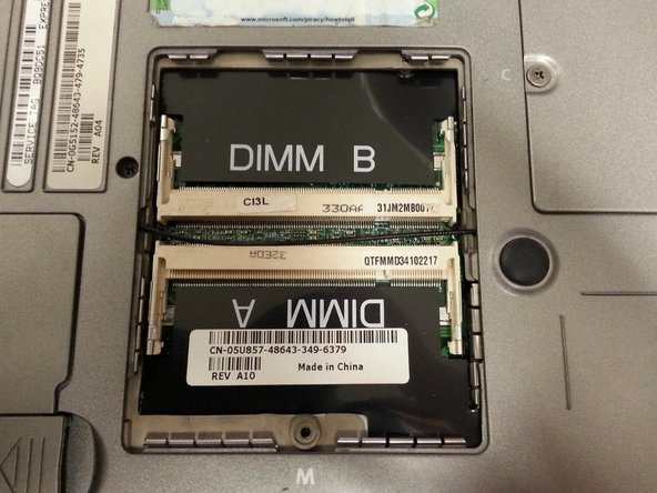 To add or replace RAM, place the memory into the slot at an angle