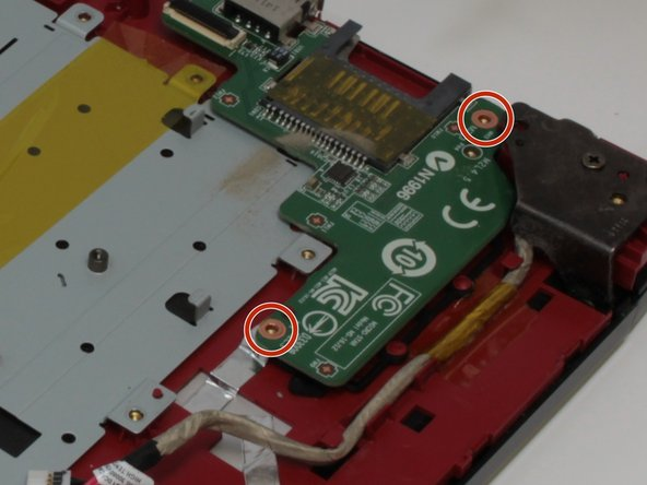 Remove the SD card reader by unscrewing the two 3 mm screws that hold it in place.