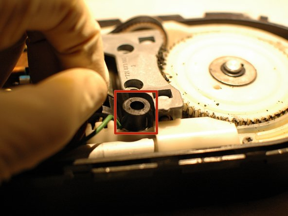 Remove the two rubber buffers that keep the case cover separated properly from the motors and gears.