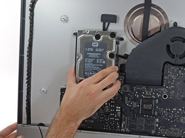 Grab the hard drive and left hard drive bracket together.
