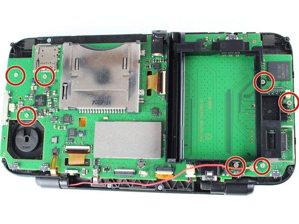 Remove the seven 3.5mm phillips screws holding down the motherboard using a PH000 screwdriver.