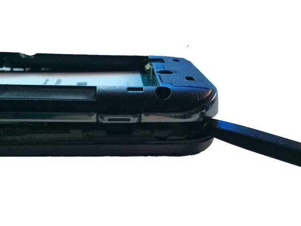 Using a spudger or plastic pry tool, slowly go around the phone between the display & rear housing to release the clips.