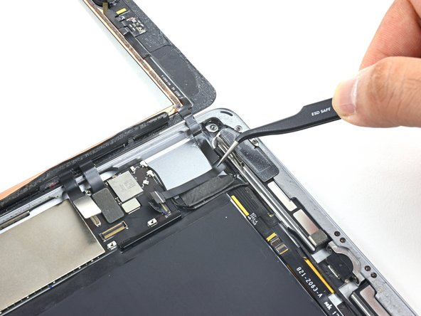 Carefully peel the home button ribbon cable up off of the adhesive holding it to the rear  case.