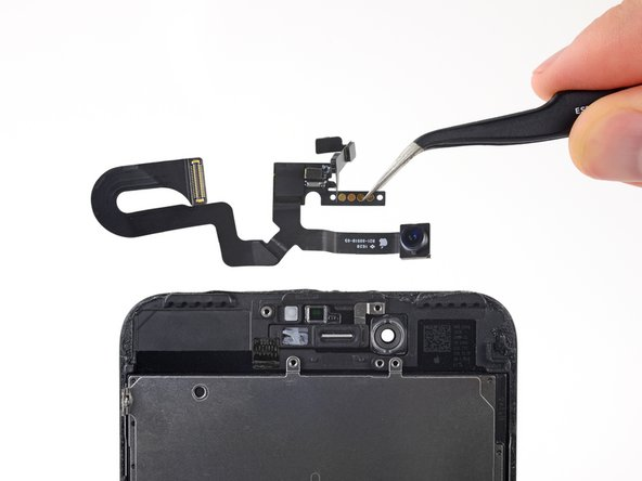 Remove the front camera and sensor cable assembly.