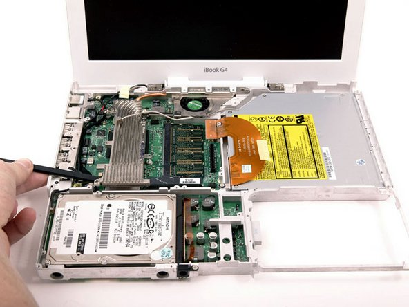 It may be necessary to soften the thermal paste between the logic board and heat sink. You can soften the thermal compound using a hairdryer. Move the hairdryer back and forth over the ribbed metal section of the heat sink for one minute. At this point, the heat sink should come free easily.