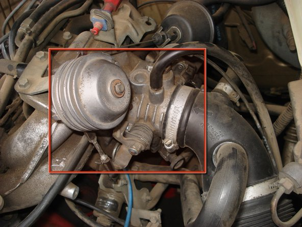 Locate throttle body on right side of engine, it is between the intake tube and intake manifold.