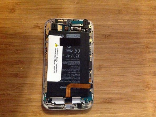 Turn the blackberry around and remove all torx screws