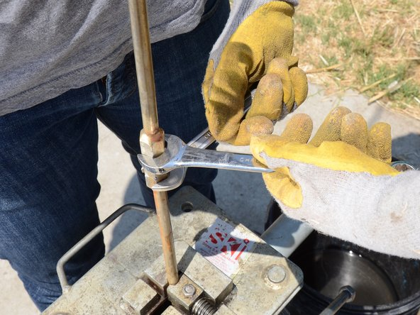 Use two wrenches to loosen the joint between the top section of pump rod and the rest of the pump rod.