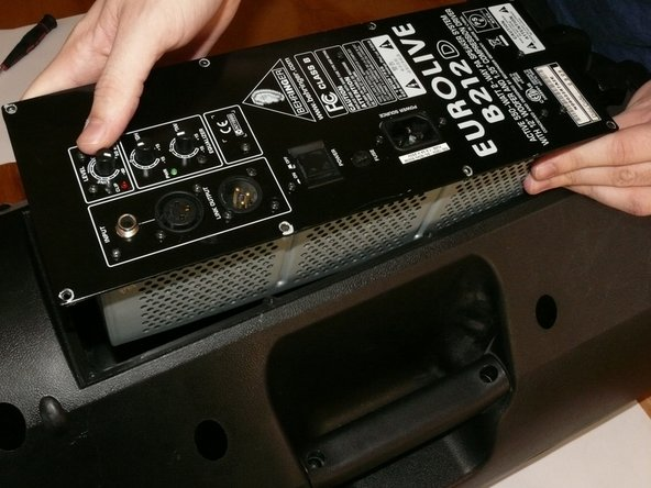 Carefully remove the back panel, lifting out the metal electronics-box with it.