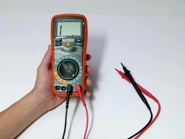 Using a multimeter (set in ohms to test resistance), test each terminal on the base of the plug to see which terminal corresponds to which speaker (left or right).  You'll know they correspond when a value other than 1 appears on the multimeter.
