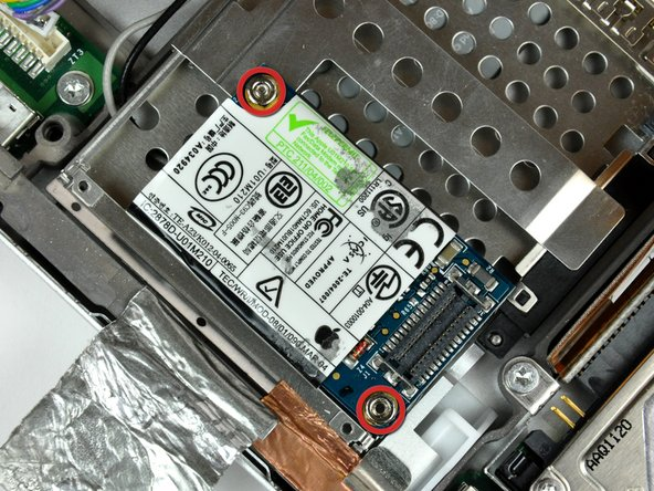 Use a 4 mm nut driver to remove the two nuts securing the modem to the PC card cage.