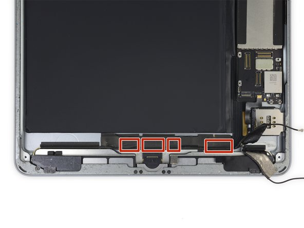 Four additional pieces of tape secure the left Wi-Fi antenna near the lower edge of the iPad.