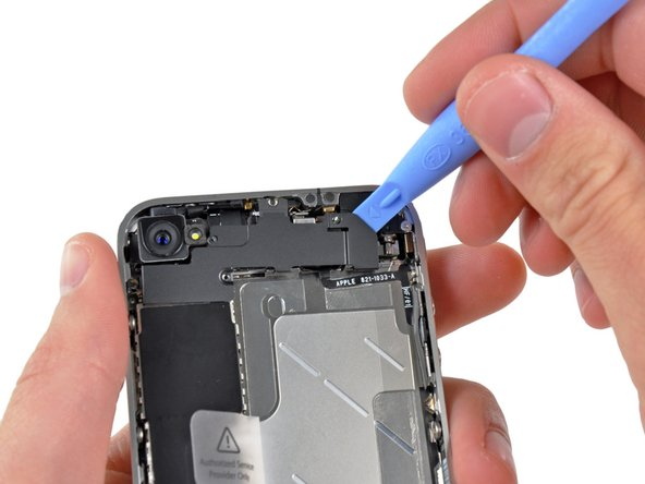 Use an iPod opening tool to slightly lift the top edge of the wi-fi antenna away from the logic board.