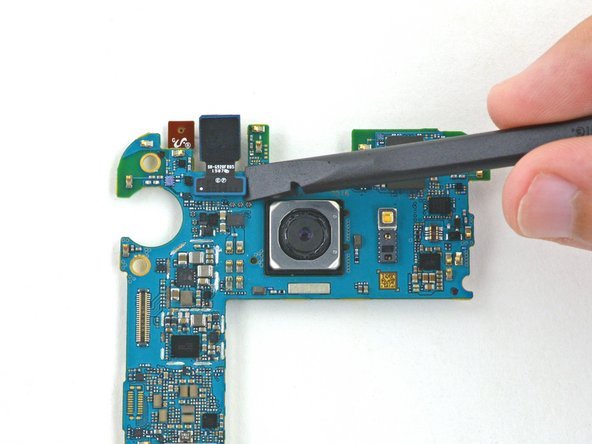 Using the flat end of a spudger, pry up the front facing camera's connector.