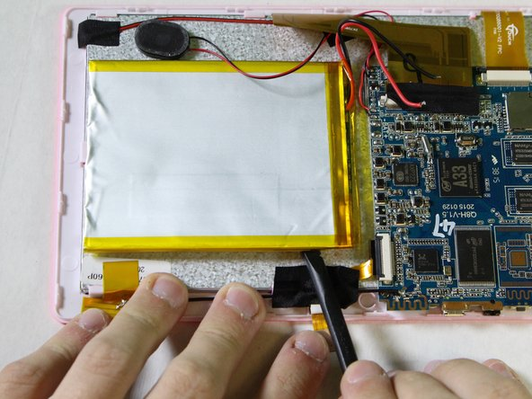 Use the nylon spudger to pry the battery from the back of the screen. Work your way around the edges, similar to opening the casing.