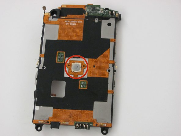 On the underside of the middle panel is the screen button and accessory parts.