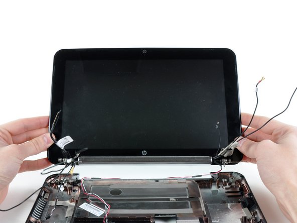 Remove the display assembly, minding any cables that may get caught or are still taped down to the lower case.