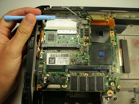 Peel back the black cover to expose the clips holding in the wireless card.