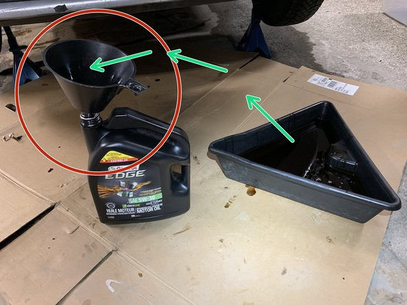 Place funnel into oil container