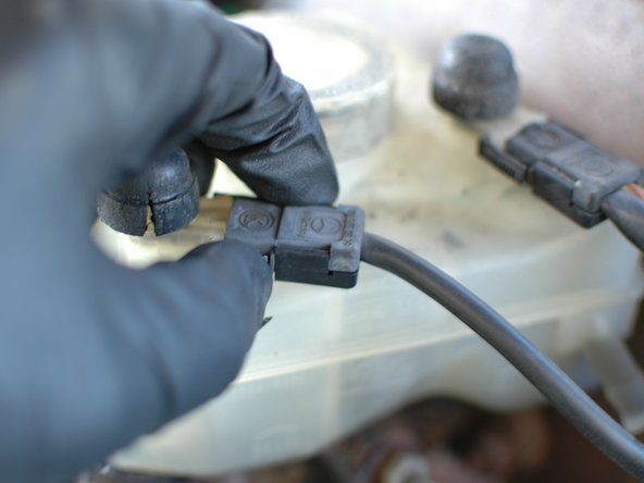 Now you can proceed to remove the reservoir. Start by unplugging the two sensor wires from each of the two floats.