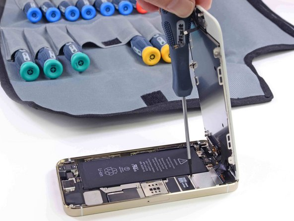 With our favorite screwdriver set, we remove a few metal connector covers and embark on the epic battle of battery removal.