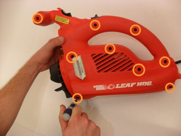 Using a Phillips #2 screwdriver, remove the ten 20 mm screws in the orange casing.