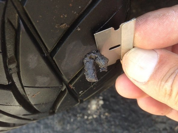 Trim the plug ends flush with the tire.