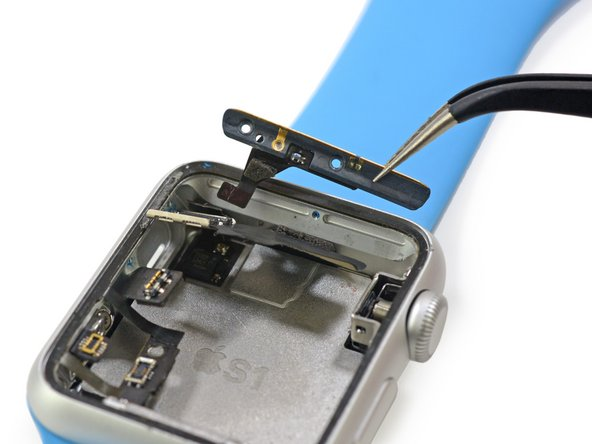 We carefully remove the antenna assembly, which is discreetly tucked into the recesses of the case.