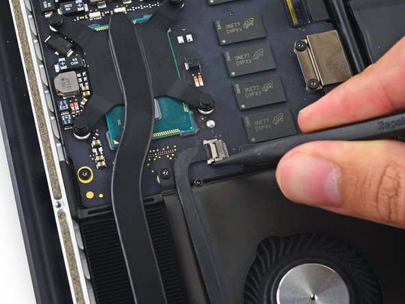 Use the tip of a spudger to push on either side of the the iSight camera cable connector to walk it out of its socket on the logic board.