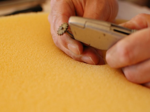 You will now want to score the shaft using a utility knife, or other sharp object. The tip of a sharp screw driver can work. Or you can rough it up with thick sandpaper. In any case, the idea is to create a surface that is rough enough to restore friction between the shaft and the grey gear.