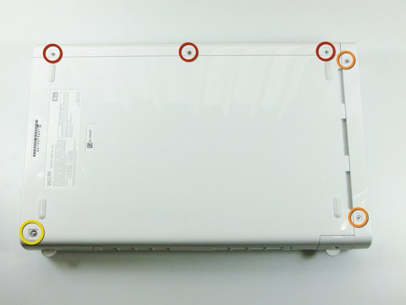 With the bottom of the console facing up, remove the following 6 screws hidden underneath the white square stickers: