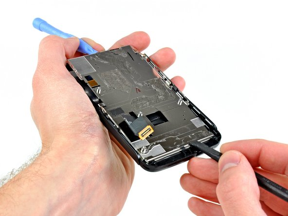 To remove the metal plate behind the LCD, simply lift its top edge slightly while pushing it toward the top of the phone.