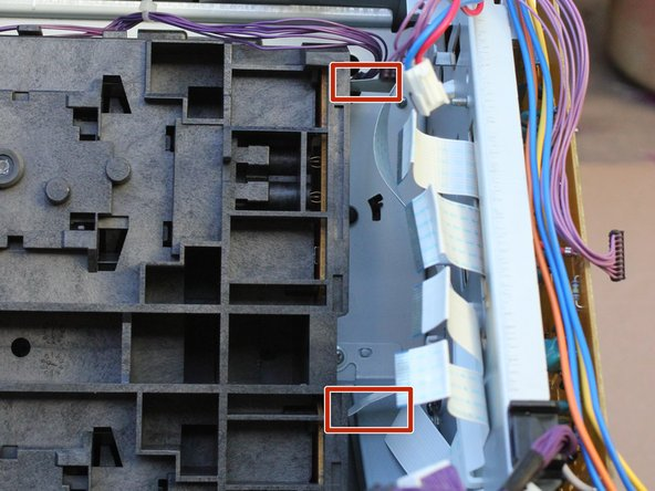 Remove the two ribbon cables gently from the optical sub-assembly.