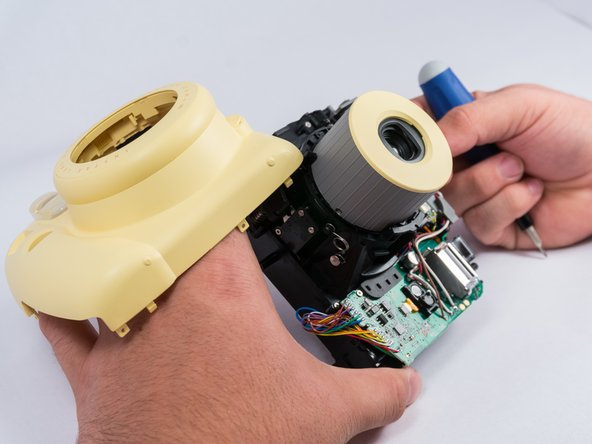 Carefully pry out the capacitor with a spudger or plastic opening tools.