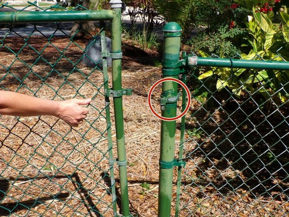 Remove the unbolted post hinges from the fence posts.