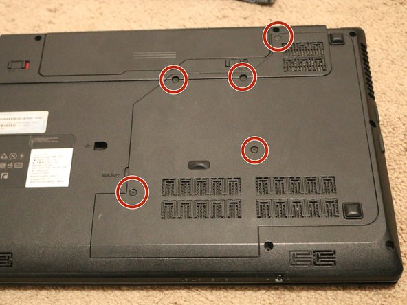 Use a Phillips #0 screwdriver to remove the five screws from the service panel on the right side.