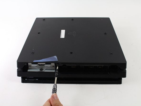 Flip the console over so the bottom is facing up.