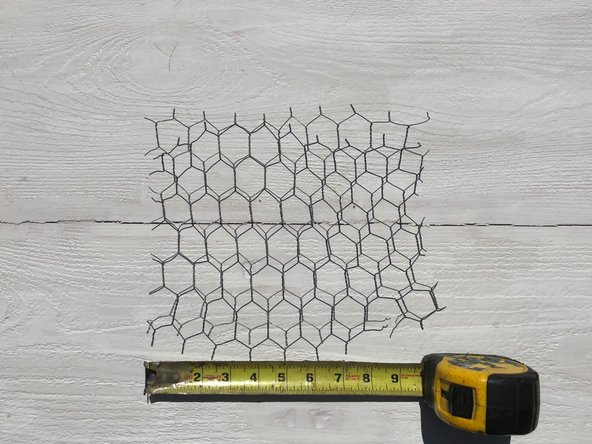 Measure a piece of chicken wire to place on top.