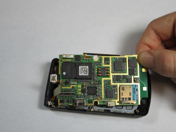 Gently grasp one of the corners of the motherboard and simply lift it straight up out of the phone casing.