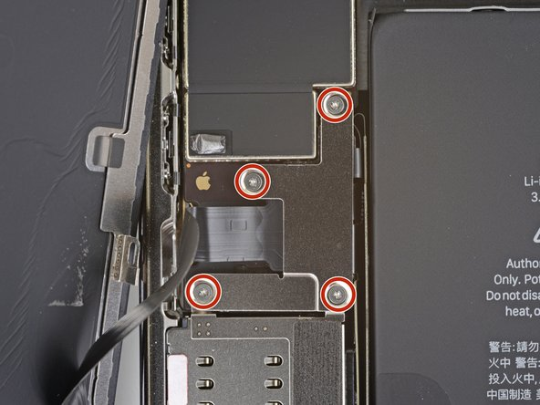 Remove four 1.1 mm-long Y000 screws securing the battery and display connector cover.