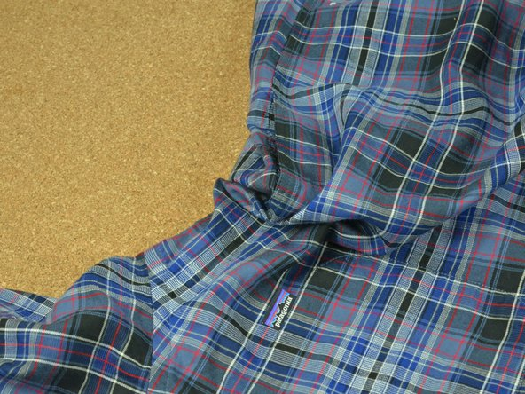 Examine the damaged seam in your garment, checking for tears and removing any loose threads.