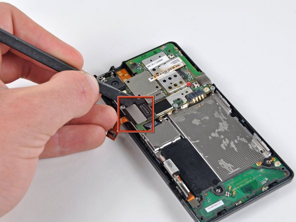 Disconnect the  display ribbon connector from its socket on the motherboard using the flat end of a spudger.