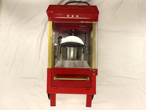 Unplug the machine and tilt the machine on its side with the pull out tray facing up.