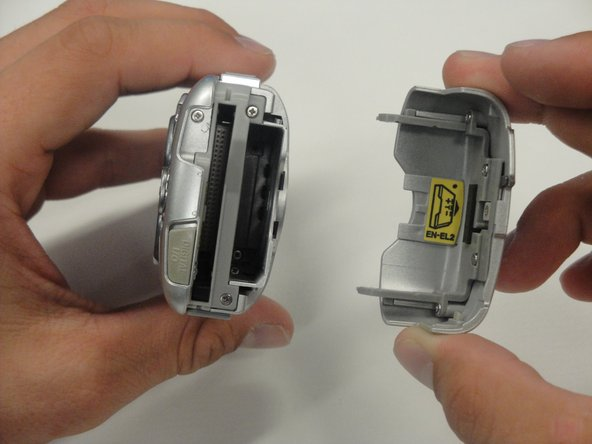 Unlatch the battery cover. Slide the cover out and flip it open.