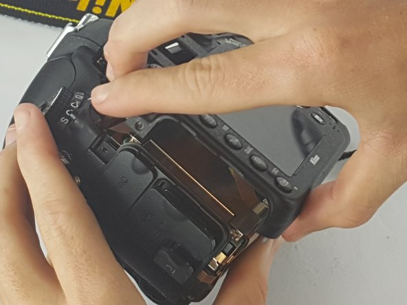 The rear face plate will include the LCD display it separates from the body of the camera with a small tug.