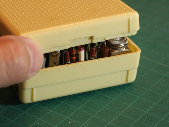 Carefully pry open the case from the bottom edge.