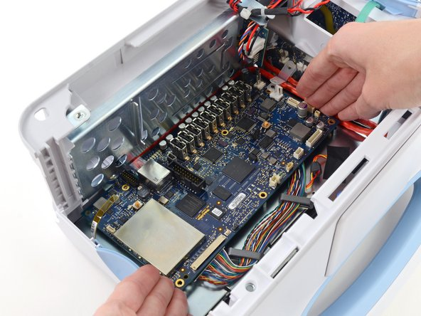 Lift the motherboard from the light-bar side and pull it toward the edge of the case to free the ethernet cable connector from under the case.